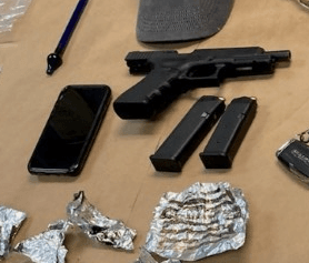 photo shows recovered pistol with two magazines and drug parafernalia