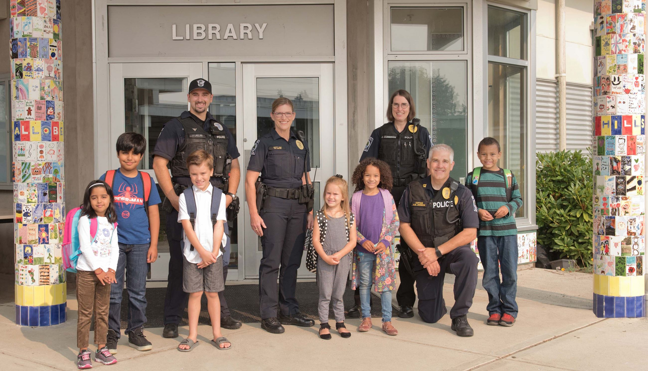 Police with kids at school library